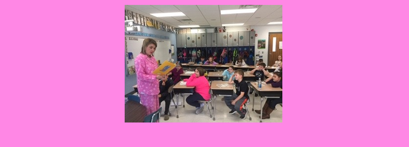 "Mrs. Smith read aloud ""Principal Fred Won't Go to Bed"" in her pajamas and fuzzy slippers for the 2nd & 3rd graders because each class read over 100 books on the 100th day!!"