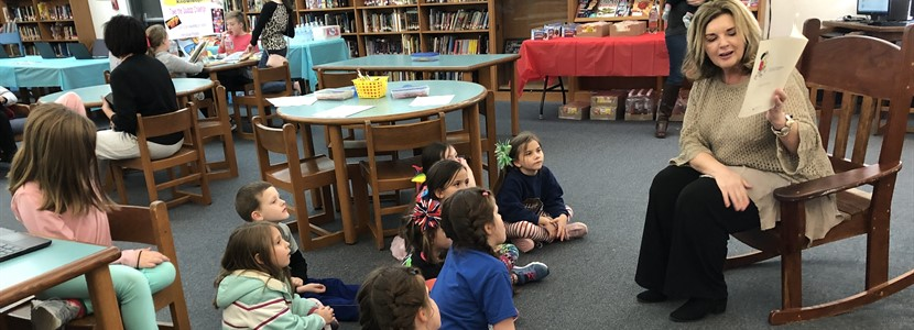 "Mrs. George read aloud during ""Read Across America"" Family Reading Night"