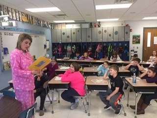 "Mrs. Smith reads aloud ""Principal Fred Won't Go to Bed"" wearing her pajamas and fuzzy slippers for 2nd & 3rd graders because each class read over 100 books on the 100th day!!"