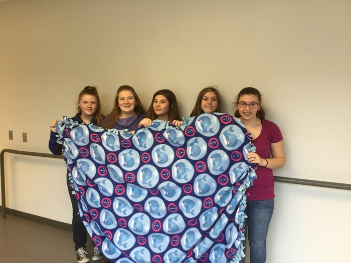 Community Outreach Members with blankets they made for the homeless shelter.