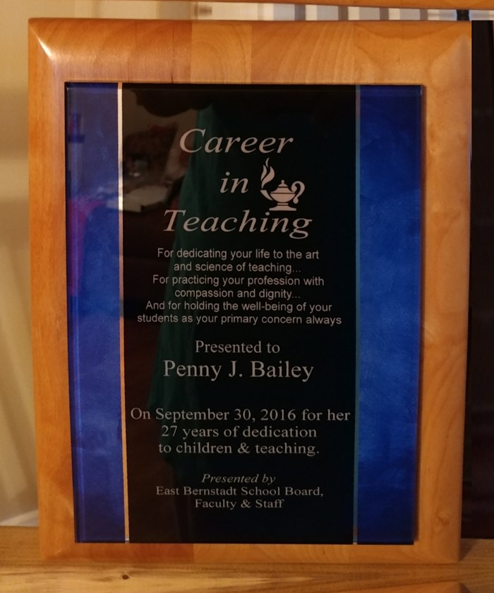 Plaque presented to Mrs. Bailey for 27 years service