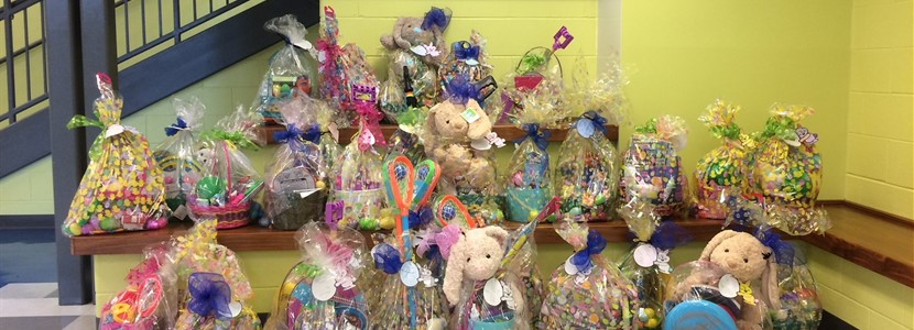 EB Middle School students fill Easter baskets for 32 students.